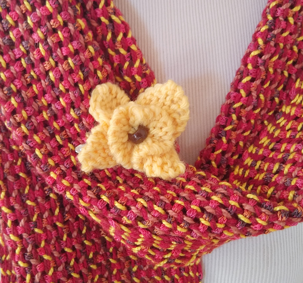 Knit flower, woven scarf