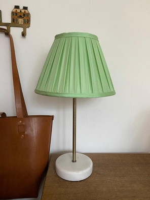 Pistachio silk in retro pleats gives this handstitched shade a mid century look.