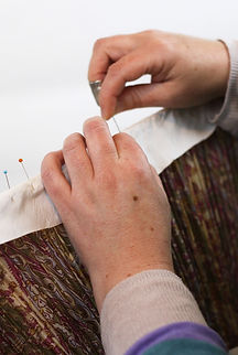 Handstitching silk lining of a traditional gathered lampshade