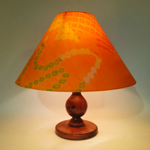 Hard lampshade in joyful shibori with a cream card lining. Shibori is a refined form of Japanese tie-dye. This fabric was the silk lining of an antique kimono which had been dismantled.