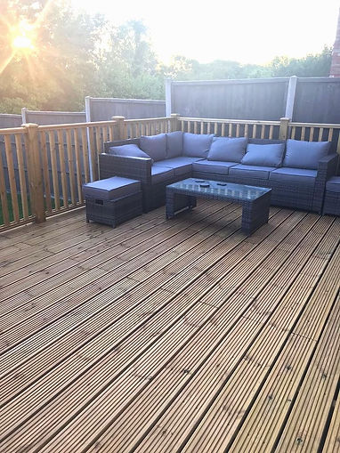 Raised timber decking with outdoor furniture