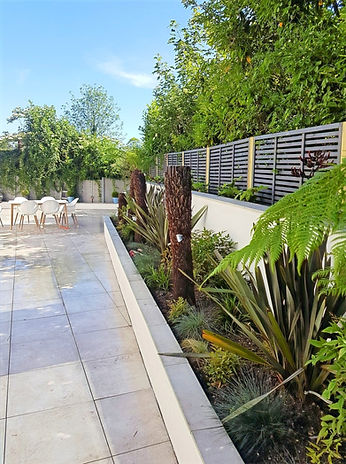Italian slate paving, raised beds with ferns & shrub planting, New walling & fence