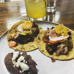 Tacos de chorizo verde on Mitla tortillas, escabeche vegetables, reprised crowder peas grown at the