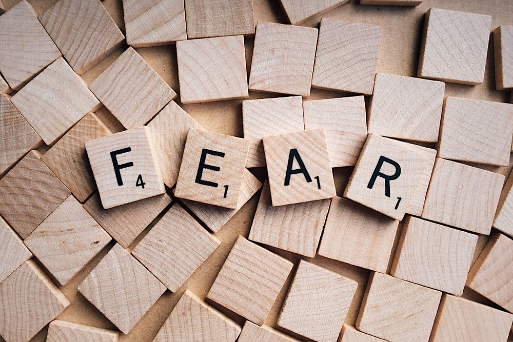 The word fear spelled out in Scrabble letters