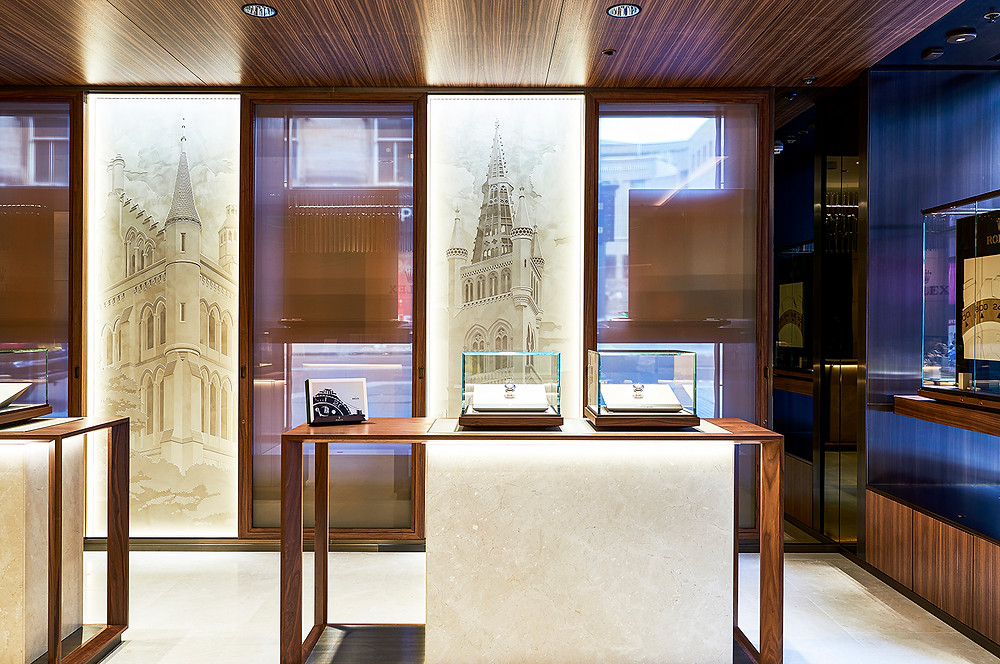 Photograph of the Rolex store in Glasgow showing the Glasgow University artwork on display