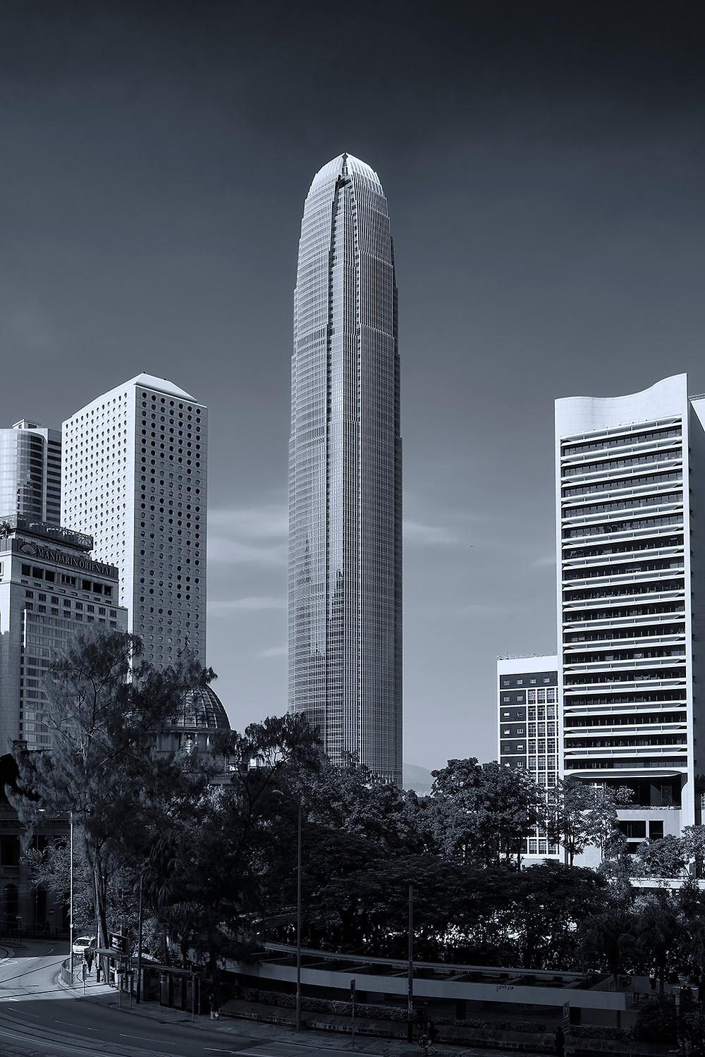 A black and white photograph of the IFC Building Two (IFC2) in Hong Kong Circa 2019