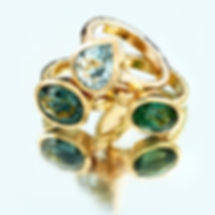 professional jewellery photographer shot of gold rings and coloured stones