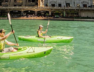 Urban Kayaks - two people paddling kayaks