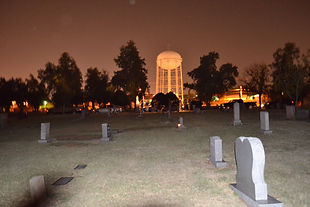 Photo was being taken of the glowing water tower. No one else was close to the photographer. Notice the shadow on the left side bottom of the photo