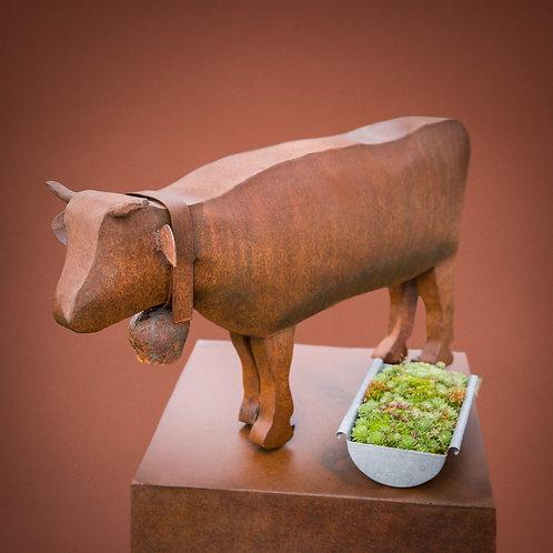 Kuh auf Monolith