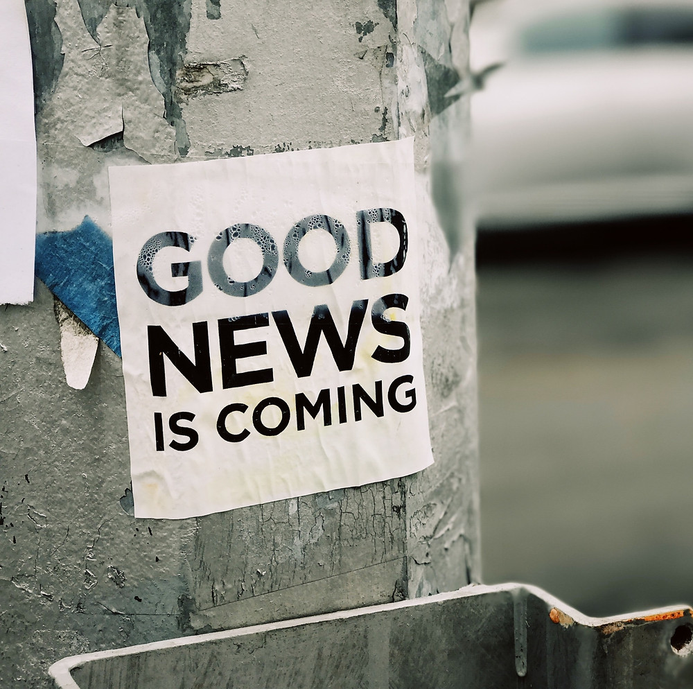 """street sign that says """"good news is coming"""""""