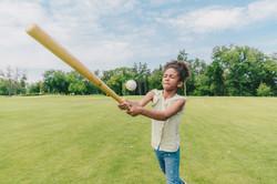 Girl Hitting Baseball