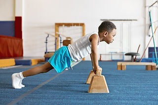 Boy Gymnastics Pushups.jpg