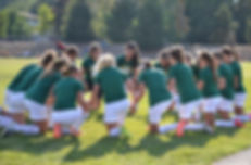 High School Girls Soccer Prayer Circle.j