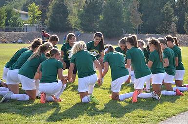 High School Girls Soccer Prayer Circle.j