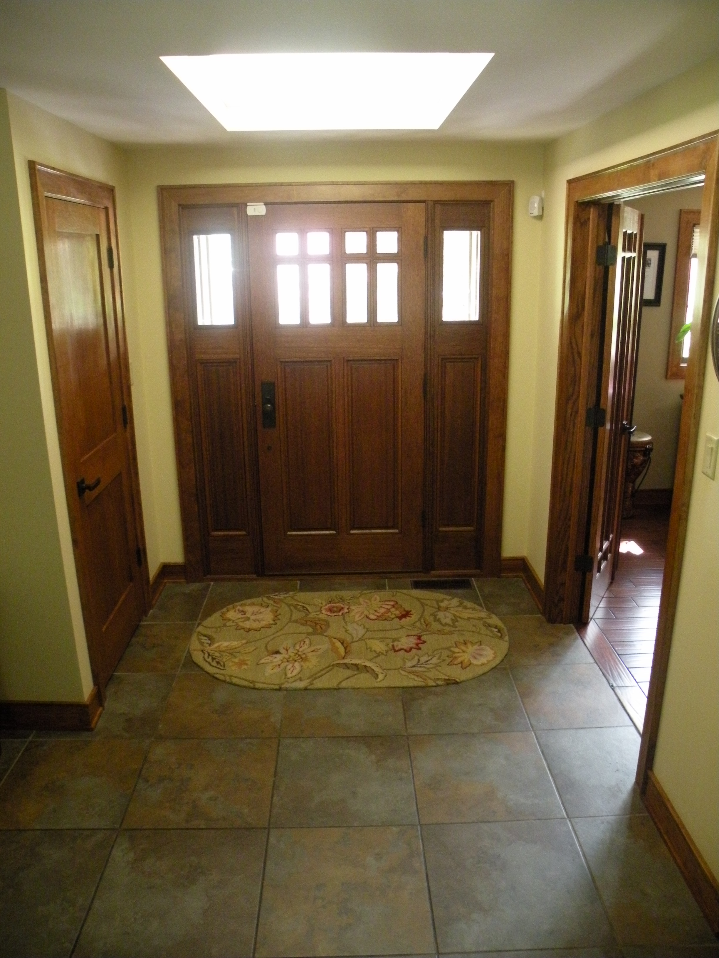Foyer with new tile, new doors