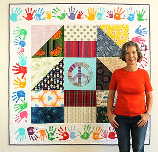 Lizzy in front of quilt.jpg