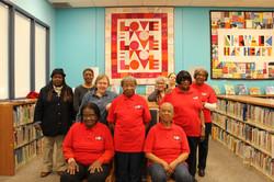 Mentors in front of LOVE quilt
