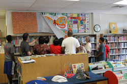 Quilt unveiling at Newfield Library