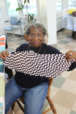 Ernestine holding one wing pieced