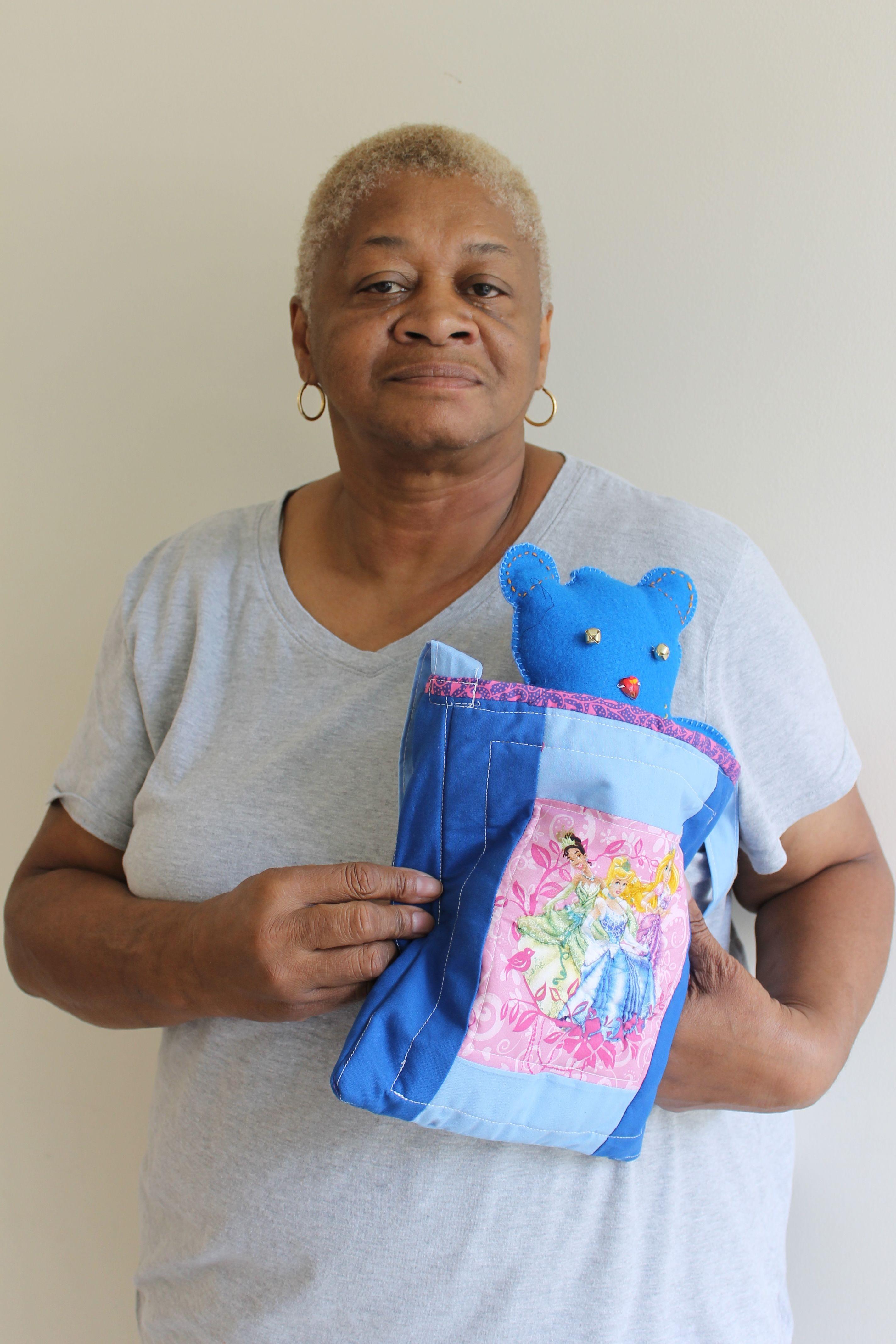 Esther with purse and felt bear