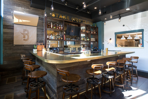 The Boomtown bar is topped with raw brass, which will develop its own patina over time.