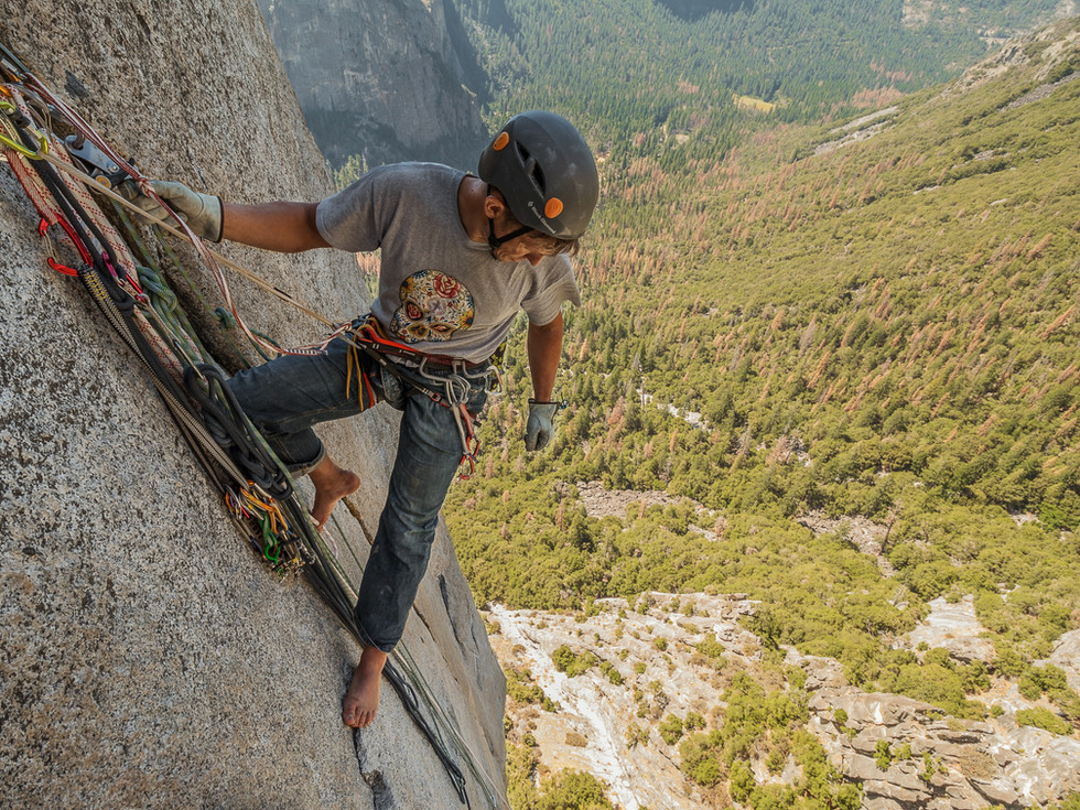 One of the things you notice in Yosemite, is the tininess of the footholds, that's why removing your climbing shoes is the first thing you do when reaching the anchor.