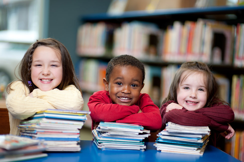 young children with stack of book