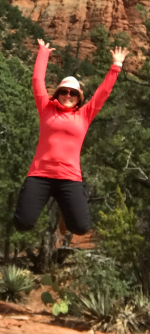 Jumping in the air with hands up