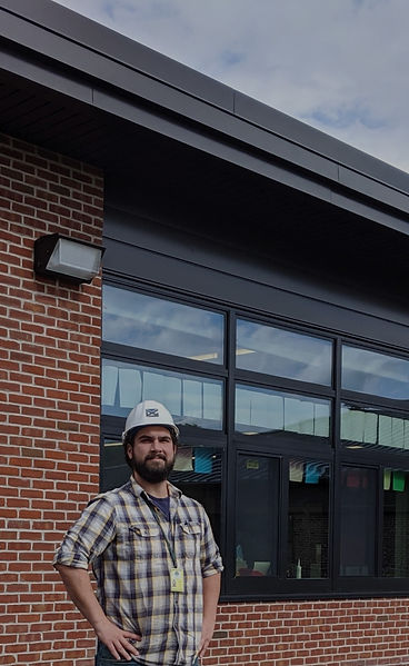 dga builders and construction group employee in front of building