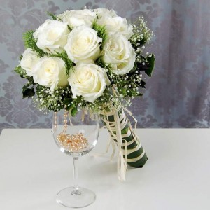roses white with greenery