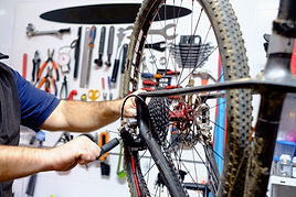 Bicycle mechanic in a workshop in the re