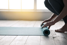 young-woman-doing-yoga-twist-mat-healthy