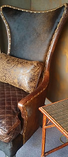 Old Hickory Tannery leather hide chair and tooled leather pillow