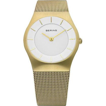 Reloj minimalista de mujer dorado 11930-334