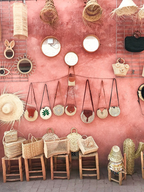 photo-of-wicker-bags-and-straw-hats-on-a