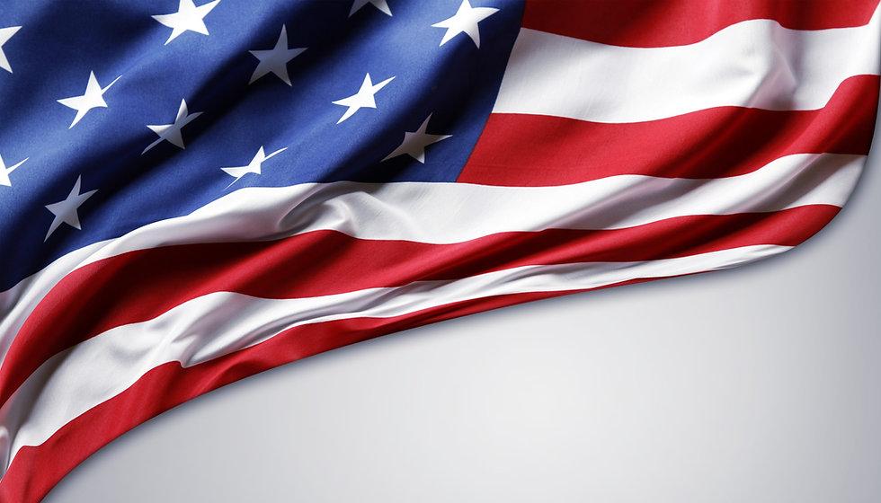 Closeup of American flag on plain backgr