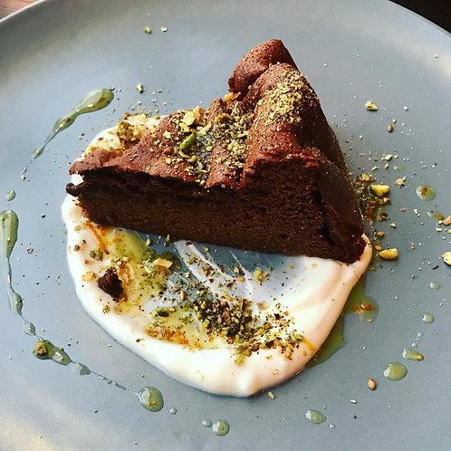 Flourless Chocolate cake with orange oil, creme fraiche & toasted almonds