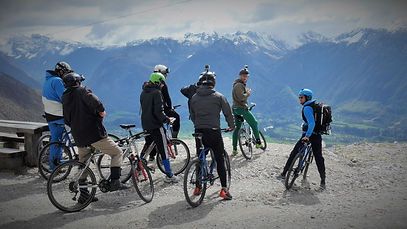 biking towards bovec in ski bike rafting event