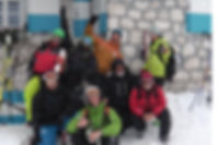 A picture of our freeride group in front of Rifugio Gilberti