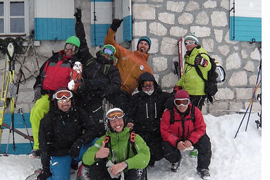 happy sella nevea mountain experienc group in front of rifugio gilberti, we skied in bovec and powder snow, sleeping in the snow