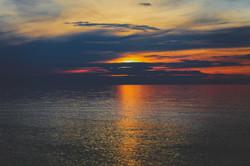 Zachód słońca na plaży w Karwii.