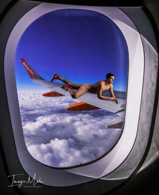 airplane-window-overlooking-clouds-12515