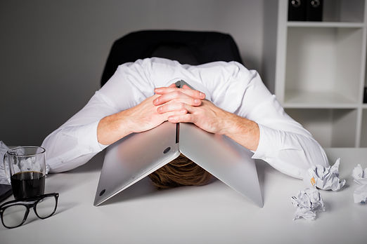 Man hiding under laptop .jpg
