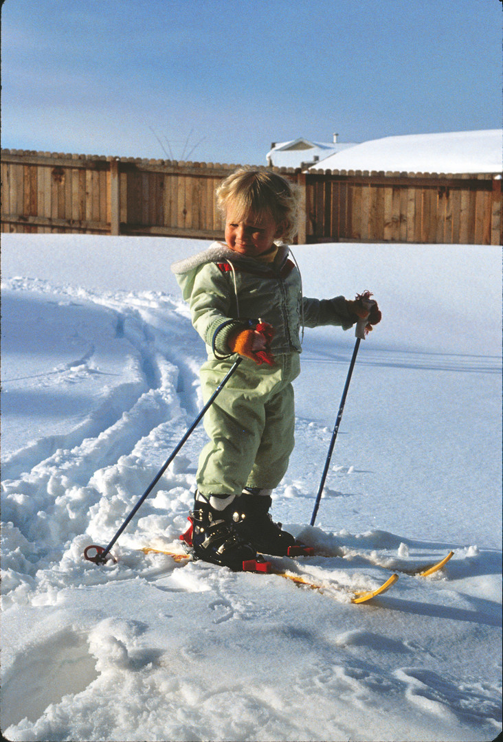 Me as a toddler learning how to ski in the backyard.
