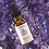 Amethyst tincture from CANNA RESERVA front view amethyst background