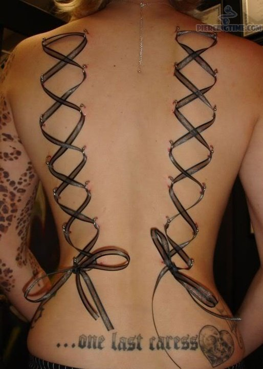 Lowerback-Piercing-And-Ribbon-Tattoos-1.