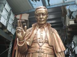 Statua in resina patinata