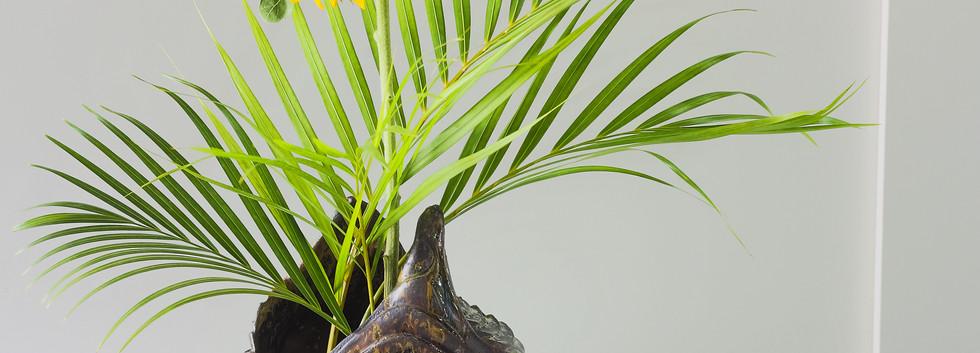 Composição com areca bambu e girassol
