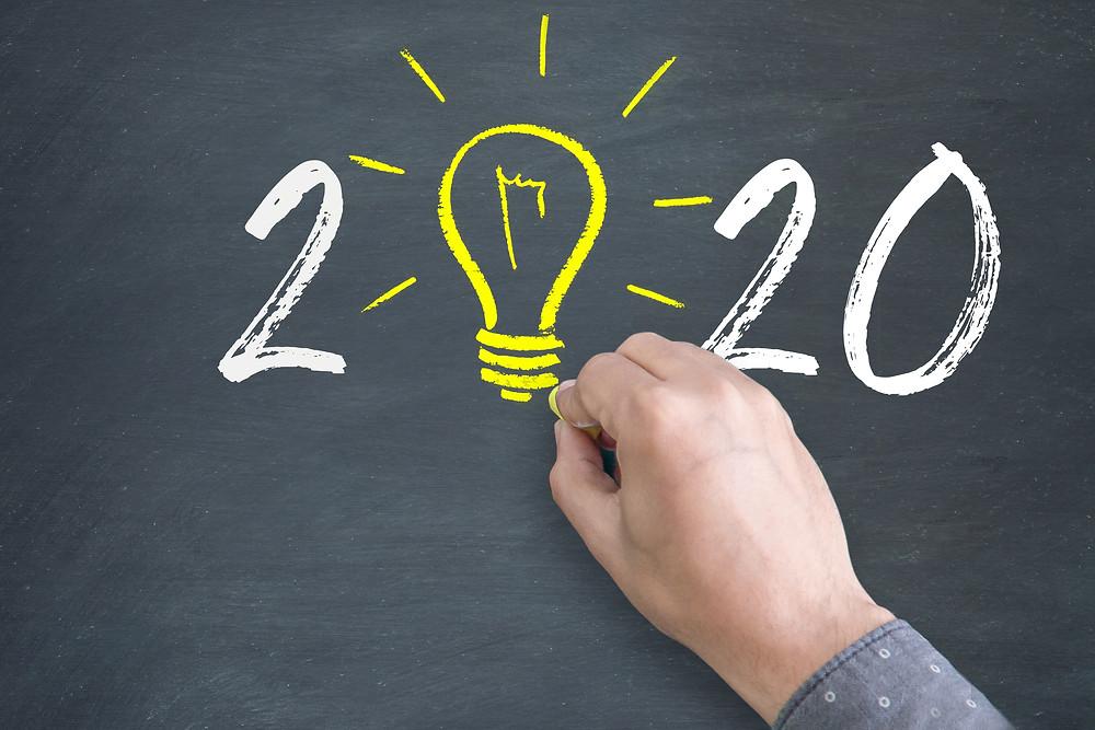 2020 written on a blackboard with a lightbulb